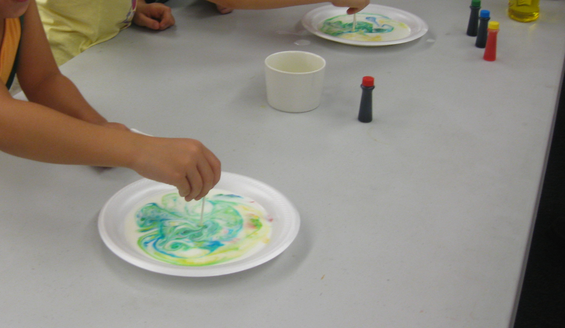 An image of food coloring in milk