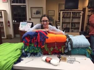 Teen poses with Project Linus Blankets.