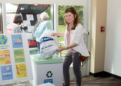 woman with Plastic Bag Recycling Station