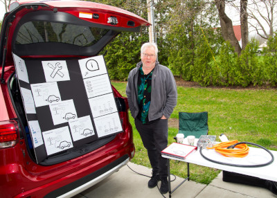man posed with Electric Vehicle Info